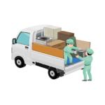 トラックに荷物を積み込む回収スタッフ